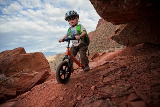 Toddler Riding Strider on Pipe Dream Trail, Utah